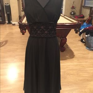 Connected apparel mid waist lace dress.